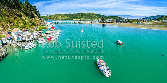 Paremata boatsheds and boats in Pauatahanui Inlet on Porirua Harbour. Aerial panorama looking towards Mana marina and Titahi Bay, Paremata, Porirua City District, Wellington Region, New Zealand (NZ) stock photo.