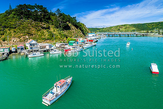 Paremata boatsheds and boats in Pauatahanui Inlet on Porirua Harbour. Aerial view from Ivey Bay looking towards Paremata Bridge, Paremata, Porirua City District, Wellington Region, New Zealand (NZ) stock photo.