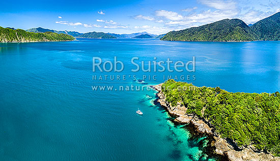 Hippa Island beside Motuara Island Scenic and Historic Reserve. Outer Queen Charlotte Sound, looking south past Long Island (left). Aerial panorama, Marlborough Sounds, Marlborough District, Marlborough Region, New Zealand (NZ) stock photo.