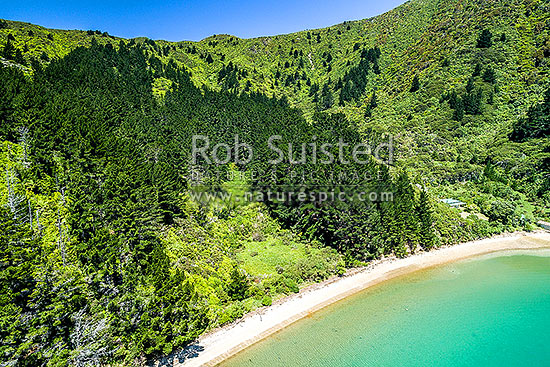 Wharehunga Bay and Wharehunga Beach, historical site from Captain Cook's visits. Aerial view in Queen Charlotte Sound, Arapawa Island, Marlborough Sounds, Marlborough District, Marlborough Region, New Zealand (NZ) stock photo.