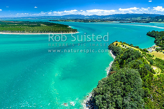 Tauranga Harbour at Katikati entrance. Papatu Point Pa, Anzac Bay and Bowentown domain at right. Matakana Island beyond. Aerial view, Bowentown, Waihi Beach, Western Bay of Plenty District, Bay of Plenty Region, New Zealand (NZ) stock photo.