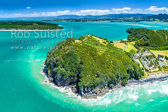 Bowentown Heads at Katikati entrance of Tauranga Harbour. Te Ho Pa site, historic Maori Pa (right) and trig on Eastern Hill, Bowentown campground right. Matakana Island top left. Aerial view, Bowentown, Waihi Beach, Western Bay of Plenty District, Bay of Plenty Region, New Zealand (NZ) stock photo.