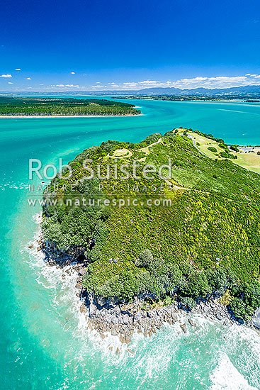 Bowentown Heads at Katikati entrance of Tauranga Harbour. Te Ho Pa site, historic Maori Pa and trig on Eastern Hill. Matakana Island top. Aerial view, Bowentown, Waihi Beach, Western Bay of Plenty District, Bay of Plenty Region, New Zealand (NZ) stock photo.