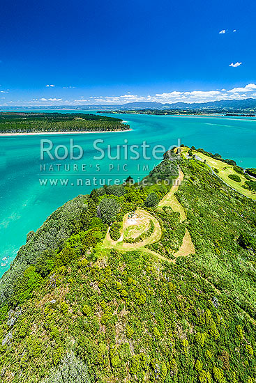 Bowentown. Te Ho Pa site and walkway tracks on Bowentown Heads at Katikati entrance of Tauranga Harbour. Historic Maori Pa and trig on Eastern Hill. Matakana Island beyond. Aerial view, Bowentown, Waihi Beach, Western Bay of Plenty District, Bay of Plenty Region, New Zealand (NZ) stock photo.