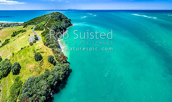 Bowentown Heads at Katikati entrance of Tauranga Harbour. Historic Maori Pa site on Papatu Point visible bottom left. Mayor (Tuhua) Island distant. Aerial view, Bowentown, Waihi Beach, Western Bay of Plenty District, Bay of Plenty Region, New Zealand (NZ) stock photo.