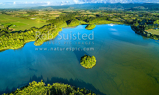 Lake Papaitonga with Motukiwi Island and Motungarara Island (front) below. Horowhenua Plains and Tararua Ranges behind. Aerial panorama. Papaitonga Scenic Reserve, Levin, Horowhenua District, Manawatu-Wanganui Region, New Zealand (NZ) stock photo.