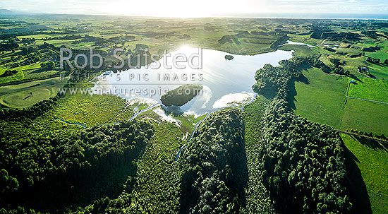 Lake Papaitonga with Motukiwi and Motungarara Islands, looking over farmland towards the coast. Aerial view. Papaitonga Scenic Reserve, Levin, Horowhenua District, Manawatu-Wanganui Region, New Zealand (NZ) stock photo.