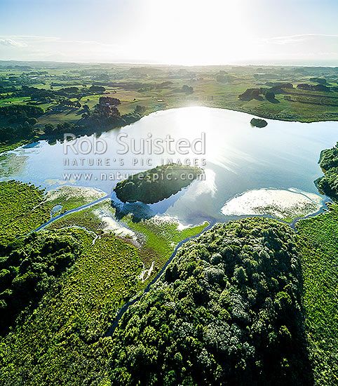 Lake Papaitonga with Motukiwi and Motungarara Islands, looking over farmland towards the coast. Papaitonga Scenic Reserve, aerial view square format, Levin, Horowhenua District, Manawatu-Wanganui Region, New Zealand (NZ) stock photo.