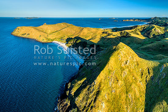 Whaorei Bay and Kauwera Point (left) with Opito Bay behind. Coastal Coromandel farmland. Mercury Islands at left. Aerial view, Opito Bay, Coromandel Peninsula, Thames-Coromandel District, Waikato Region, New Zealand (NZ) stock photo.