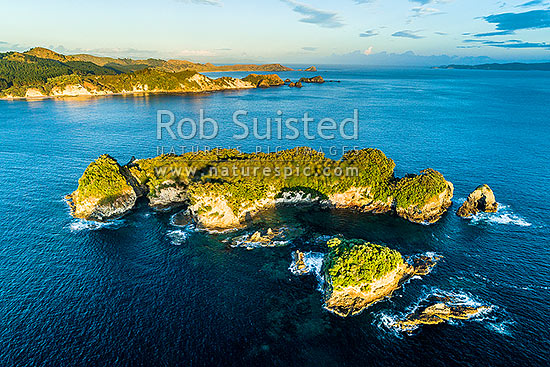 Motukoruenga Island with Red Bay and Opito Point (centre behind). Aerial view, Opito Bay, Coromandel Peninsula, Thames-Coromandel District, Waikato Region, New Zealand (NZ) stock photo.