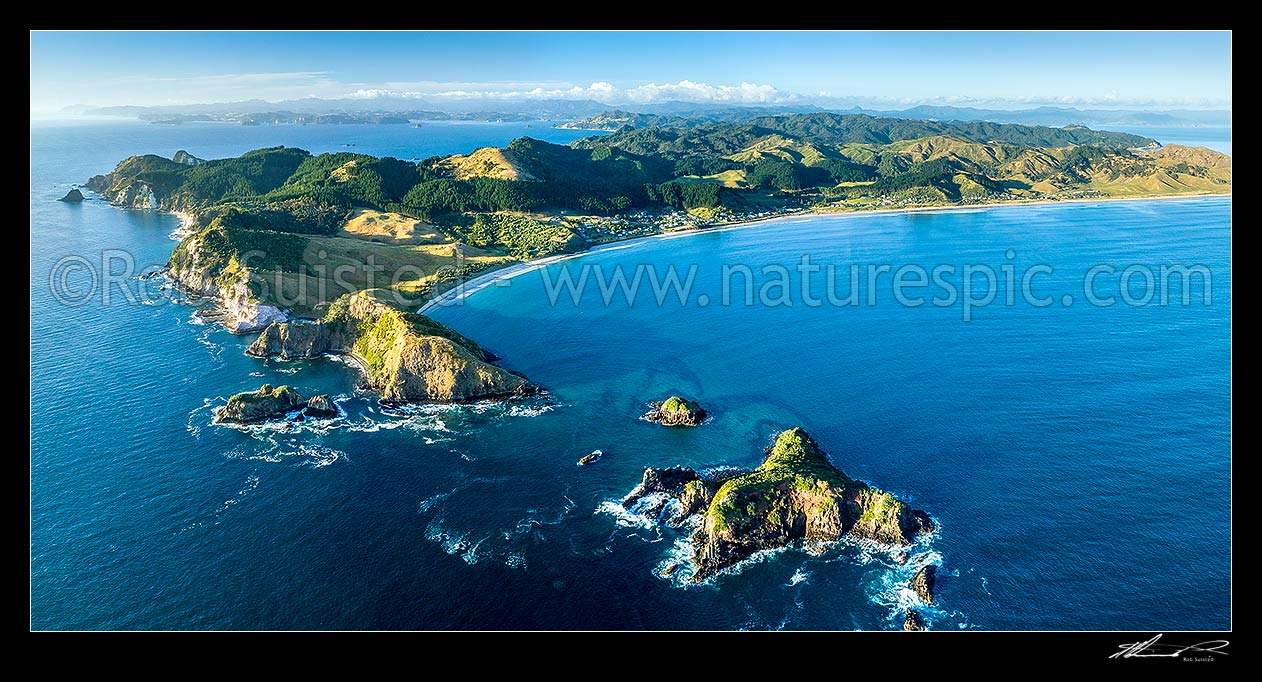 Image of Opito Bay and Opito Beach aerial panorama. Opito Point at left and Rabbit Island foreground. Mercury Bay distant left, Opito Bay, Coromandel Peninsula, Thames-Coromandel District, Waikato Region, New Zealand (NZ) stock photo image