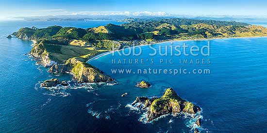 Opito Bay and Opito Beach aerial panorama. Opito Point at left and Rabbit Island foreground. Mercury Bay distant left, Opito Bay, Coromandel Peninsula, Thames-Coromandel District, Waikato Region, New Zealand (NZ) stock photo.