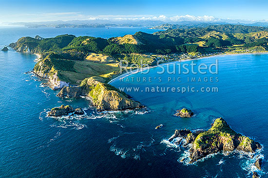 Opito Bay and Opito Beach aerial view. Opito Point centre and Rabbit Island bottom right. Mercury Bay behind, Opito Bay, Coromandel Peninsula, Thames-Coromandel District, Waikato Region, New Zealand (NZ) stock photo.