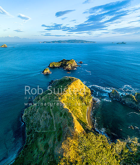 Opito Point Historic Reserve and Rabbit Island. Mercury Islands and Great Mercury Island beyond. Aerial view, Opito Bay, Coromandel Peninsula, Thames-Coromandel District, Waikato Region, New Zealand (NZ) stock photo.