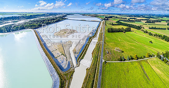 Rangitata South Irrigation Scheme water storage reservoirs or ponds beside the Rangitata River, used to irrigate surrounding farmland. Aerial view looking south east, Arundel, Timaru District, Canterbury Region, New Zealand (NZ) stock photo.