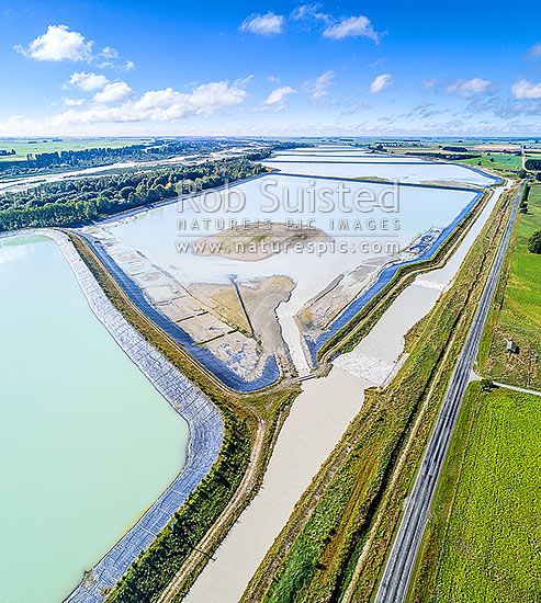 Rangitata South Irrigation Scheme water storage reservoirs or ponds beside the Rangitata River, used to irrigate surrounding farmland. Aerial view, square format, Arundel, Timaru District, Canterbury Region, New Zealand (NZ) stock photo.