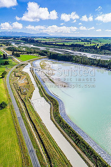 Rangitata South Irrigation Scheme water storage reservoirs or ponds beside the Rangitata River, used to irrigate surrounding farmland. Aerial view looking north west, Arundel, Timaru District, Canterbury Region, New Zealand (NZ) stock photo.