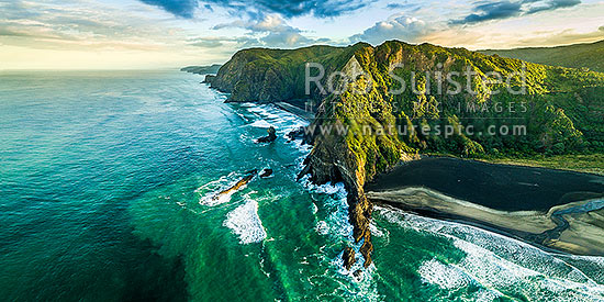 Karekare Beach and Union Bay (right), looking north past Farley Point and Mercer Bay to Te Ahua Point. Waitakere Ranges beyond. Aerial view, Karekare Beach, Waitakere City District, Auckland Region, New Zealand (NZ) stock photo.