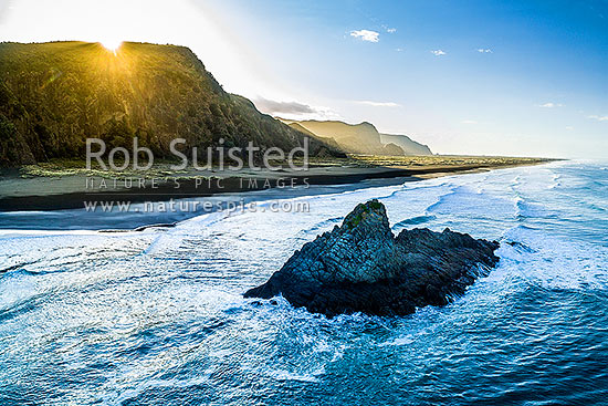 Karekare Beach Point and Panatahi Island at sunrise. Whakaruro Bay and Whatipu beyond. Waitakere Ranges. Aerial, Karekare Beach, Waitakere City District, Auckland Region, New Zealand (NZ) stock photo.