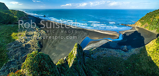 Karekare Beach, Karekare Stream and Union Bay, seen from above The Watchman. Panatahi Island at left, Farley Point at right. Aerial panorama, Karekare Beach, Waitakere City District, Auckland Region, New Zealand (NZ) stock photo.