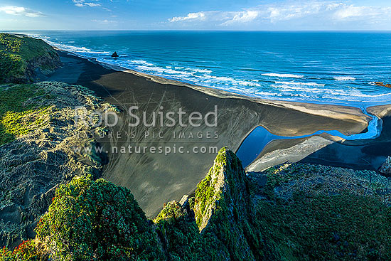Karekare Beach, Karekare Stream and Union Bay, seen from above The Watchman. Panatahi Island at left.  Aerial view, Karekare Beach, Waitakere City District, Auckland Region, New Zealand (NZ) stock photo.