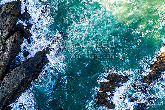 Rocky turbulent coastline seen from above. Aerial view, Karekare Beach, Waitakere City District, Auckland Region, New Zealand (NZ) stock photo.