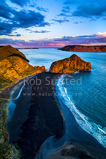 Manukau Harbour entrance at Whatipu Beach, with Paratutae Island centre. South Head and Awhitu beyond right. Aerial view at dusk, Whatipu Beach, Waitakere City District, Auckland Region, New Zealand (NZ) stock photo.