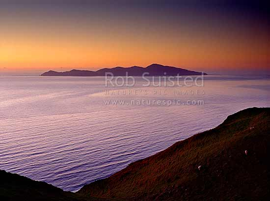 Kapiti Island at sundown from the Paekakariki Hill, Paekakariki, Kapiti Coast District, Wellington Region, New Zealand (NZ) stock photo.
