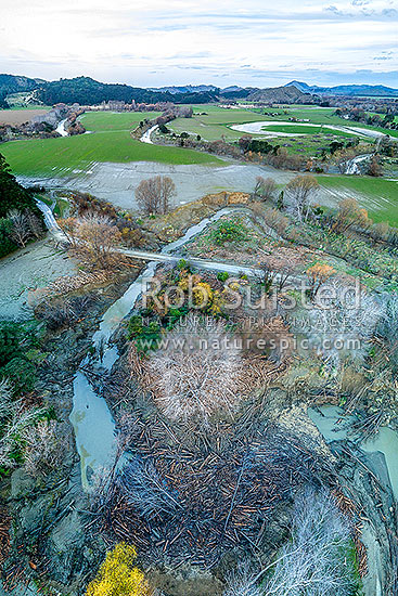 Forestry slash lying in the Mangatokerau River after the Tolaga Bay 2018 floods. Aerial view, Tolaga Bay, Gisborne District, Gisborne Region, New Zealand (NZ) stock photo.