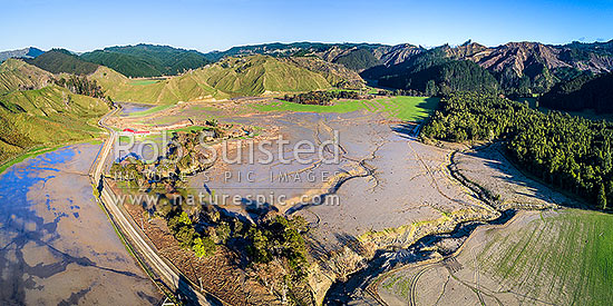 Tolaga Bay floods in June 2018 brought large amounts of forestry timber slash and topsoil down Tapuwae Stream to inundate farmland on Paroa Road. Aerial panorama. Note forestry slash foregound, Tolaga Bay, Gisborne District, Gisborne Region, New Zealand (NZ) stock photo.