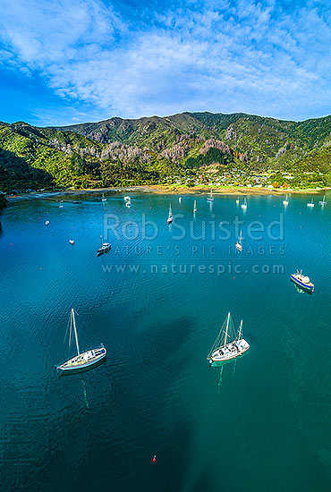 Ngakuta Bay and settlement in Grove Arm. Aerial view over moored yachts and vessels in bay, Marlborough Sounds, Marlborough District, Marlborough Region, New Zealand (NZ) stock photo.