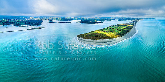 Ohiwa Harbour mouth, looking west over Port Ohope, towards Ohope Beach and Kohi Point distant right. Aerial panorama. Whangakopikopiko Island left, Ohope, Bay of Plenty, Western Bay of Plenty District, Bay of Plenty Region, New Zealand (NZ) stock photo.