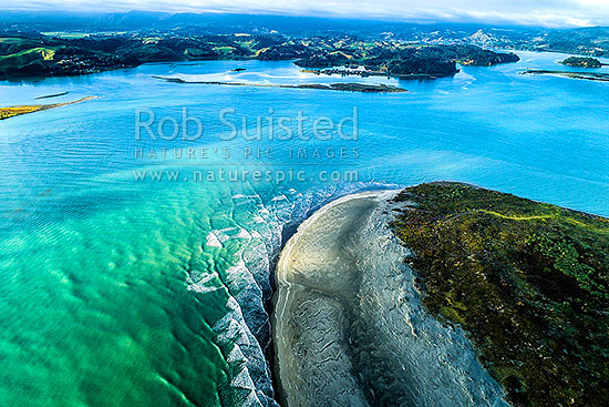 Ohiwa Harbour mouth, looking east over Ohiwa. Whangakopikopiko Island top centre. Aerial view, Ohope, Bay of Plenty, Western Bay of Plenty District, Bay of Plenty Region, New Zealand (NZ) stock photo.