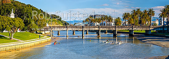 Gisborne City and Turanganui River, with young people practicing Waka Ama outrigger canoe racing near the Gladstone Road Bridge. Panorama, Gisborne City, Gisborne District, Gisborne Region, New Zealand (NZ) stock photo.