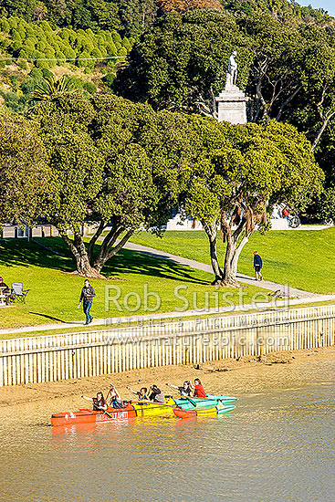 Gisborne City and Turanganui River, with young people practicing Waka Ama outrigger canoe racing, Gisborne City, Gisborne District, Gisborne Region, New Zealand (NZ) stock photo.
