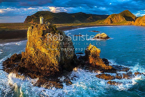 Ninepin Rock and lighthouse (or beacon) by Whatipu Beach. Aerial view, Whatipu Beach, Waitakere City District, Auckland Region, New Zealand (NZ) stock photo.