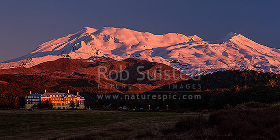 Mt Ruapehu (2797m) above the Grand Chateau at Whakapapa Village. Panorama at dusk, Tongariro National Park, Ruapehu District, Manawatu-Wanganui Region, New Zealand (NZ) stock photo.