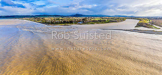 Tukituki River mouth and estuary, in flood after heavy rain. Town of Haumoana at left, with Te Mata Peak beyond. Aerial panorama, Clive, Hastings District, Hawke's Bay Region, New Zealand (NZ) stock photo.