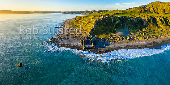 Baring Head lighthouse and East Harbour Regional Park. Aerial panorama, with Wellington Harbour entrance at left. Fitzroy Bay centre, Baring Head, Hutt City District, Wellington Region, New Zealand (NZ) stock photo.