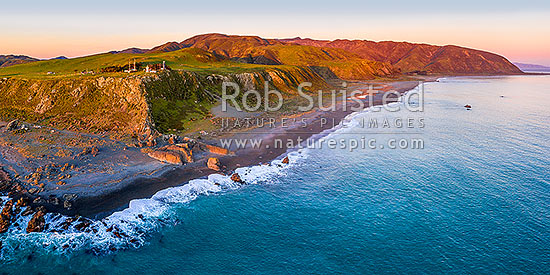 Baring Head lighthouse aerial panorama with Wainuiomata River mouth, Orongorongo Station and Turakirae Head at right. East Harbour Regional Park at dusk, Baring Head, Hutt City District, Wellington Region, New Zealand (NZ) stock photo.