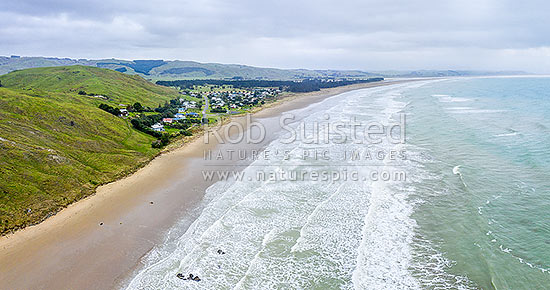 Porangahau Beach settlement on Porangahau Beach, with Porangahau River mouth in distance. Aerial view towards Blackhead Point, Porangahau, Hawke's Bay Region, New Zealand (NZ) stock photo.