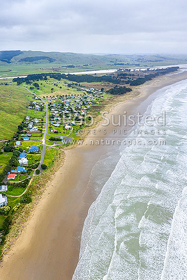 Porangahau Beach settlement on Porangahau Beach, with Porangahau River behind. Aerial view, square format, Porangahau, Hawke's Bay Region, New Zealand (NZ) stock photo.
