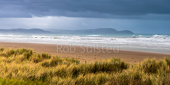Porangahau Beach on a moody day, looking north towards Blackhead Point at right. Panorama, Porangahau, Hawke's Bay Region, New Zealand (NZ) stock photo.