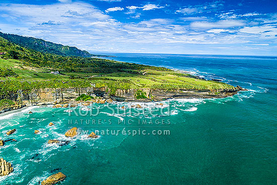 Punakaiki Coast. Perpendicular Point and Irimahuwheri Bay in Paparoa National Park. Aerial view looking south towards Dolomite Point, Paparoa National Park, Buller District, West Coast Region, New Zealand (NZ) stock photo.