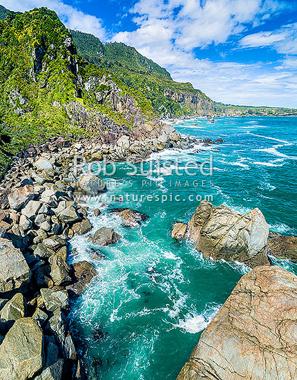 Punakaiki Coast. Irimahuwheri Bay and rocky coastline at Gentle Annie Rocks. Aerial view looking south towards Perpendicular Point, Paparoa National Park, Buller District, West Coast Region, New Zealand (NZ) stock photo.