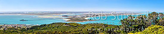 Tiwai Point aluminium smelter, with bulk carrier ship Africa Bulker unloading Bauxite to Tiwai Point aluminium smelter via Tiwai Wharf. Toetoes Bay far right. Panorama, Bluff, Invercargill District, Southland Region, New Zealand (NZ) stock photo.