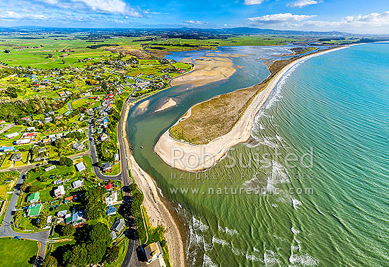 Maketu Estuary and Kaituna River mouth (top right) seen from above Maketu township. Aerial view, Maketu, Western Bay of Plenty District, Bay of Plenty Region, New Zealand (NZ) stock photo.