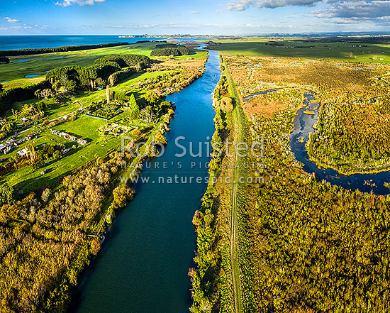 Kaituna River mouth and Lower Kaituna Wetlands at right. Maketu Estuary, Maketu township and Okurei Point beyond. Aerial view, Maketu, Western Bay of Plenty District, Bay of Plenty Region, New Zealand (NZ) stock photo.