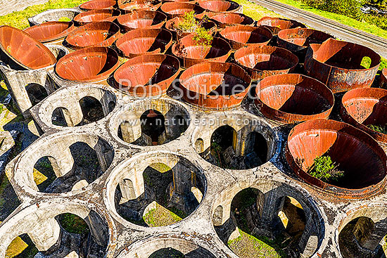 Historic cyanide settling tanks at the old Victoria Gold Battery site. 10th biggest gold stamper battery in the world. Karangahake Gorge gold mining area. Aerial view, Waikino, Waihi, Hauraki District, Waikato Region, New Zealand (NZ) stock photo.