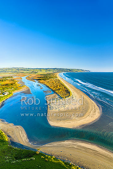 Oraka Beach on Mahia Peninsula, with Maungawhio Lagoon and Kopuawhara Stream mouth to sea. Looking along Pukenui Beach to Mahanga Beach (centre). Aerial view, Mahia, Wairoa District, Hawke's Bay Region, New Zealand (NZ) stock photo.